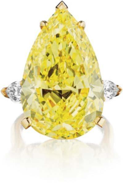 206: A Superb Fancy Intense Yellow Diamond Ring.