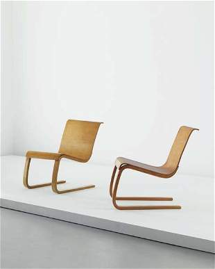 157: ALVAR AALTO, Pair of cantilevered low chairs, mode