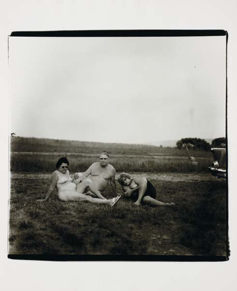 17: DIANE ARBUS, A family one evening in a nudist camp,