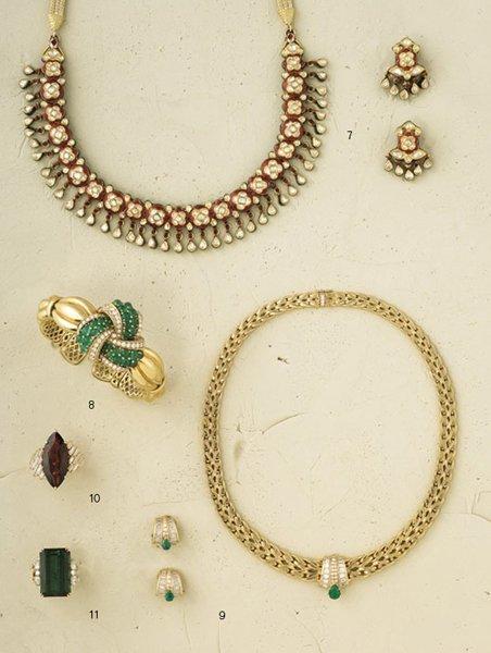 10:        A Diamond and Garnet Dress Ring, circa 1975
