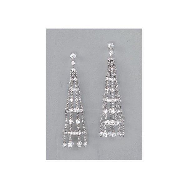 8:        A Pair of Diamond Earrings  Each circular-cut