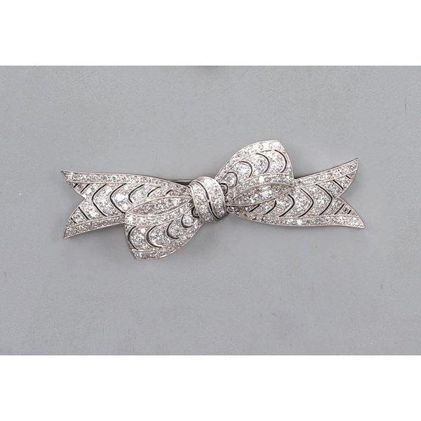 9:        A Diamond Bow Brooch  Designed as a pierced o