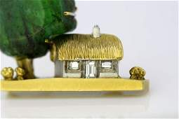 18kt yellow gold brooch with emerald and diamond