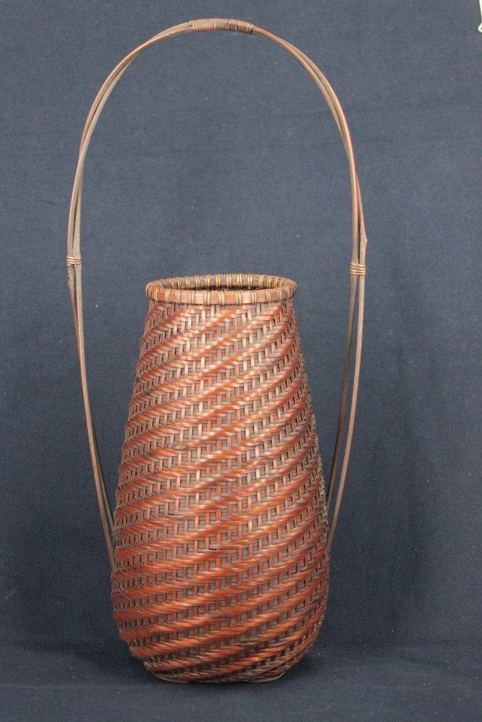 A Japanese signed Ikebana basket with bamboo holder