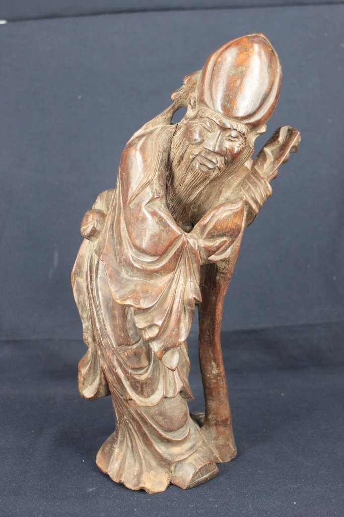 A solid wood carving god of longevity