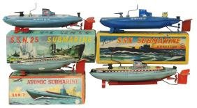 Toy boats (4), Japanese SAN submarines, litho on metal,