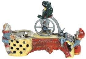 """Mechanical bank, """"Professor Pug Frog's Great Bicycle"""