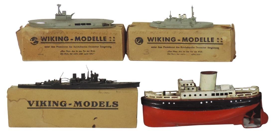 Toy boats (4), metal German tanker & 3 Viking-Models,