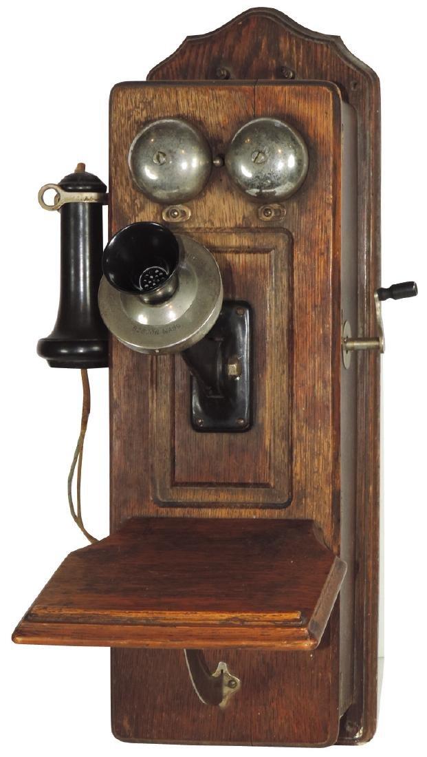 Telephone, oak wall phone w/shelf, mfgd by S.H. Couch