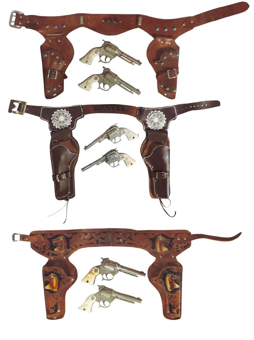 Toy guns & holsters (3), tooled leather horse head