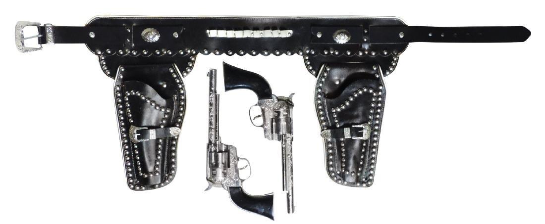 "Toy cap guns & holster, Hubley, Exc wkg cond, 40""L."