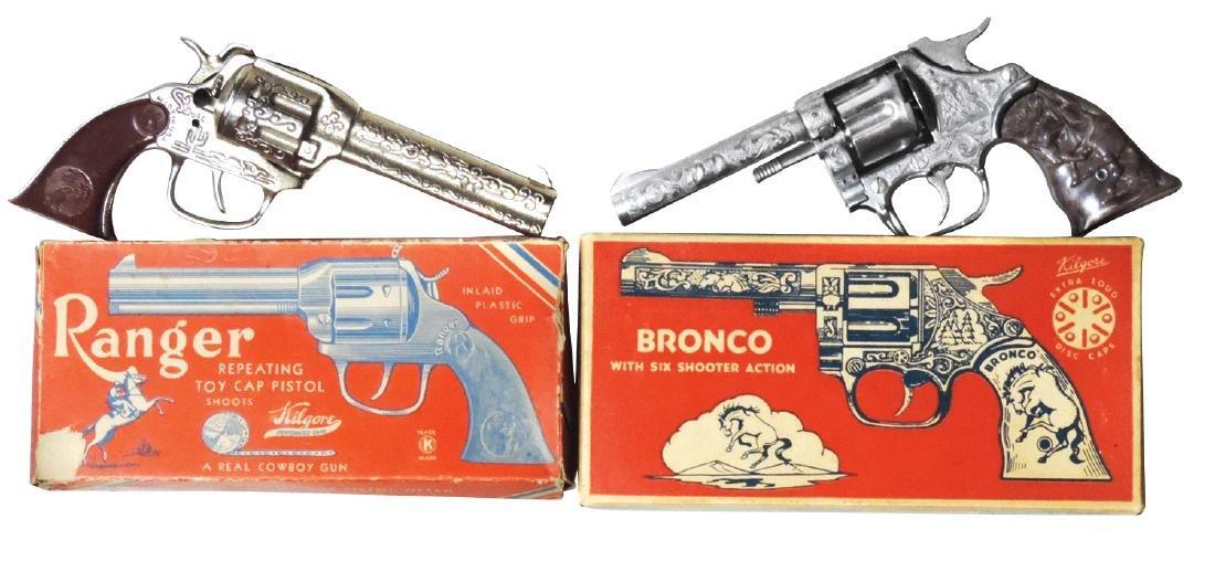 Toy cap guns (2), Kilgore, No. 209 Bronco & No. 12