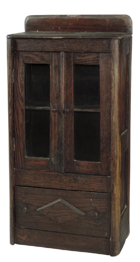Children's cupboard, alligatored oak w/2 glass-front