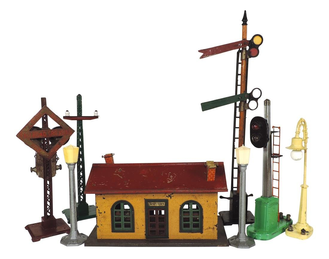 Toy train accessories (8) Lionel #127 station, 2 street