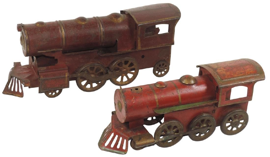 Toy train locomotives (2), both pressed steel hill