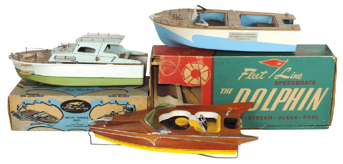 Toy boats (3) & (2) boxes, Aristo Craft on wire stand &