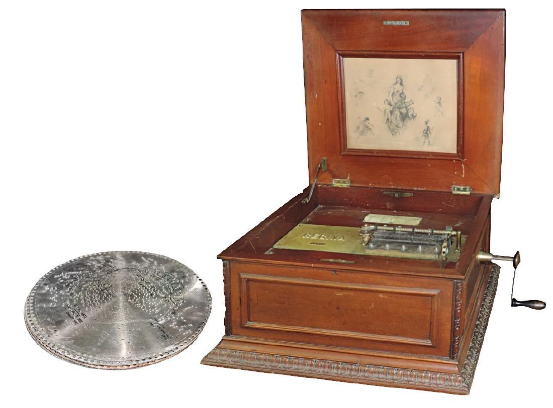 Music box, Regina disc player, table-top oak cabinet,