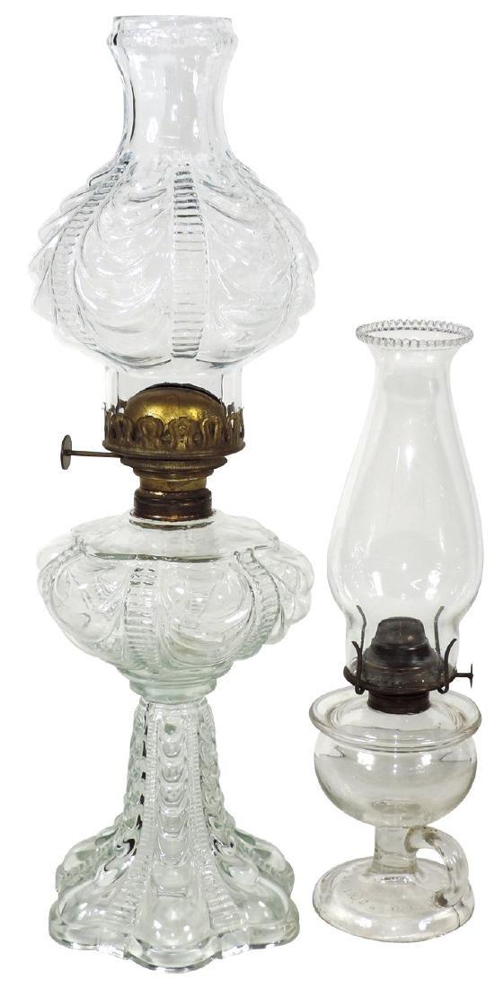 Lamps (2), Kerosene/oil clear glass table lamps, taller