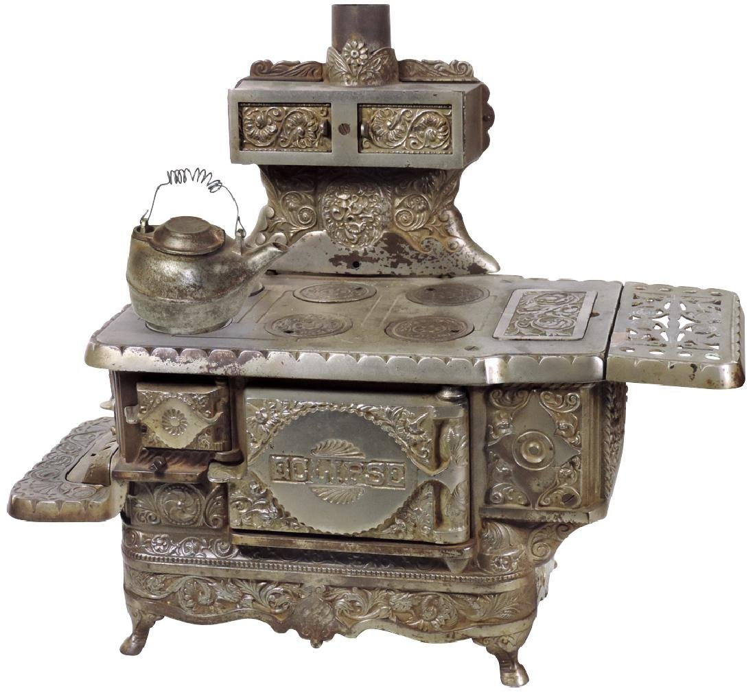 "Toy cook stove, ""Eclipse"", mfgd by J. & E. Stevens, cas"