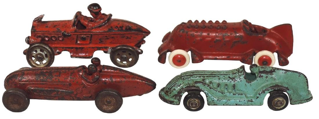 Toy race cars (4), 1 marked Arcade 1457, 1 w/driver &