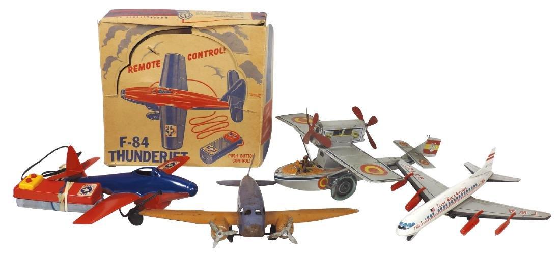 Toy airplanes (4), German tin windup seaplane marked