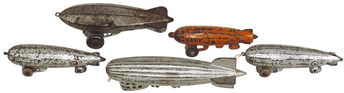 Toy zeppelins (5), cast iron, 1 w/slot for coins, all