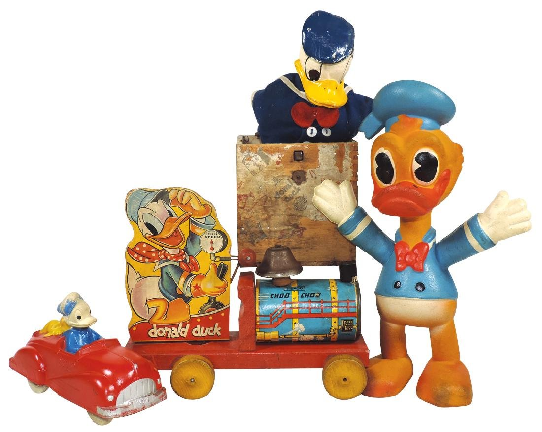Donald Duck toys (4), rubber Donald marked WD