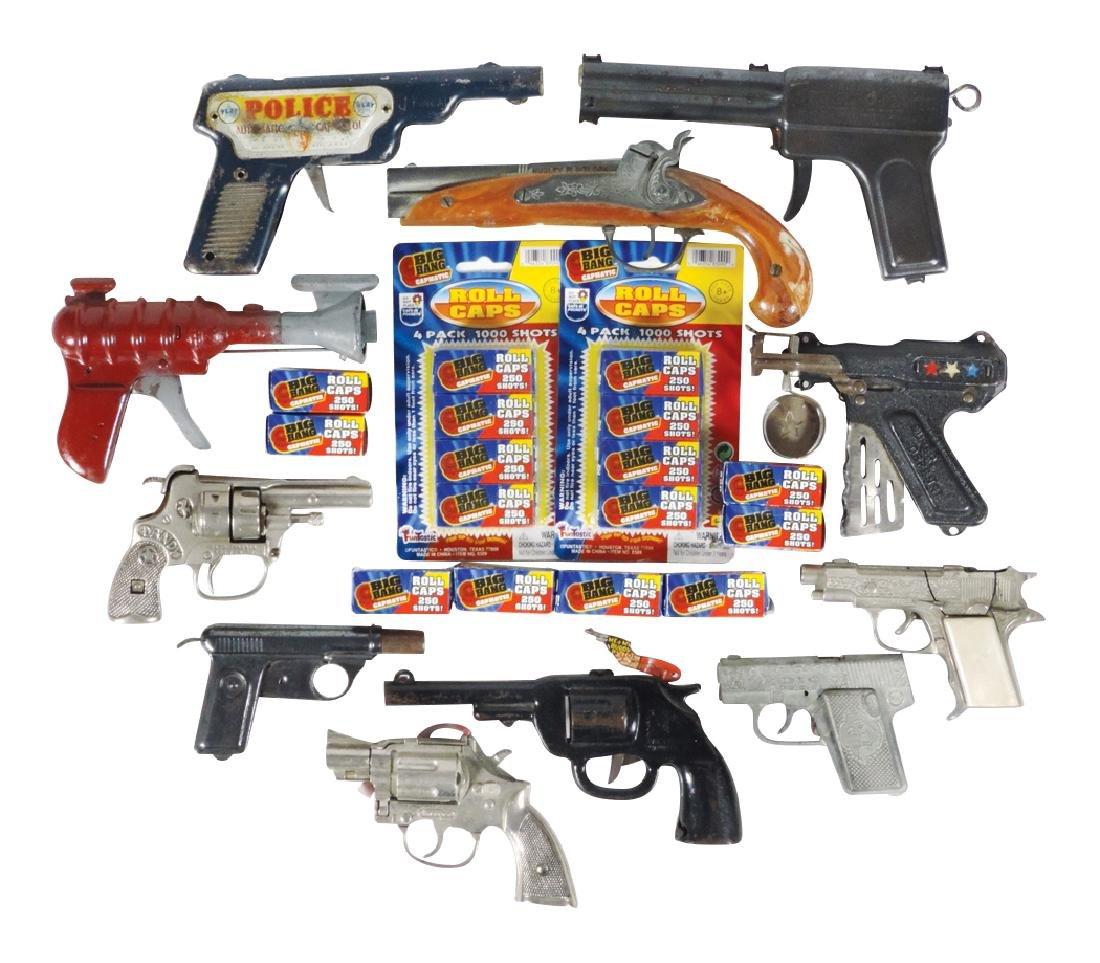 Toy cap guns (11) plus caps, Hubley Dandy cast iron,