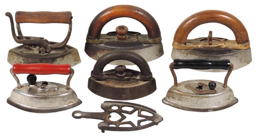 Children's toy sad irons & trivet (7), cast metal