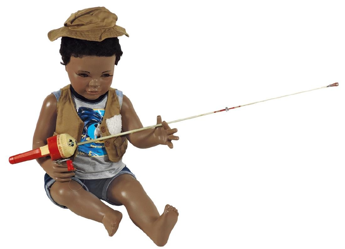 Mannequin, seated Black child w/Mickey Mouse fishing