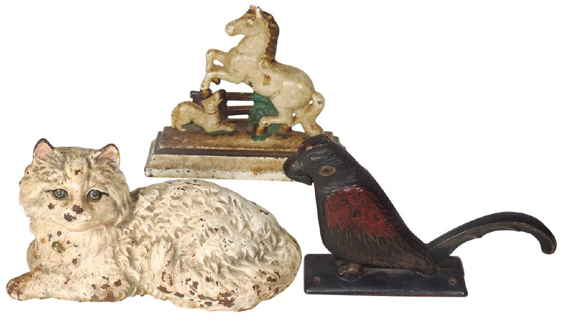 Cast iron doorstops & nut cracker (3), Hubley reclining