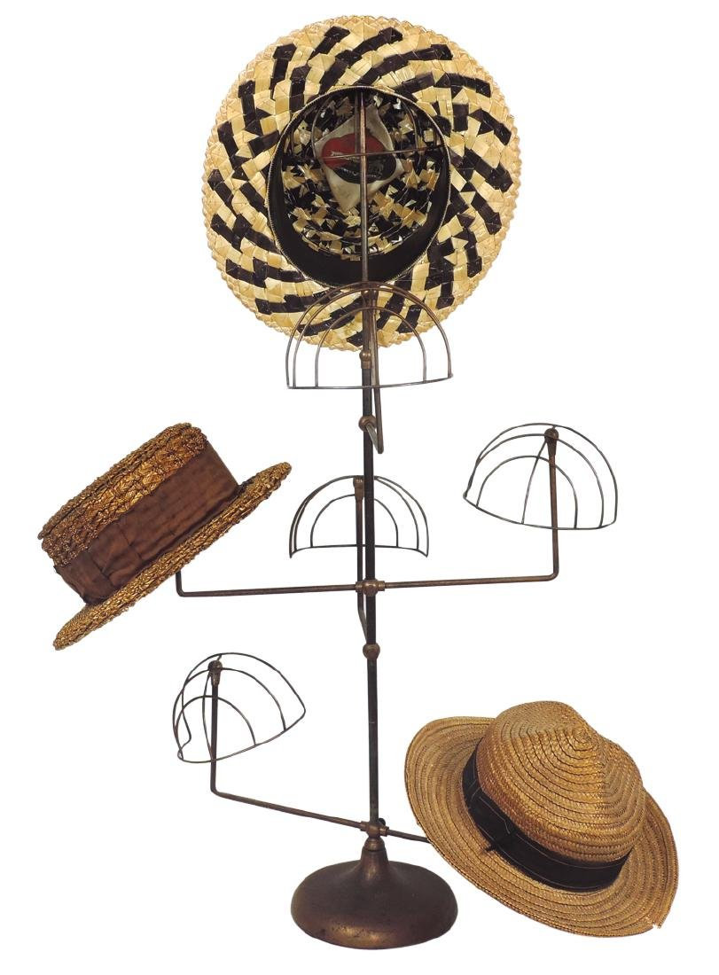 Country store hat stand w/hats, cast iron base