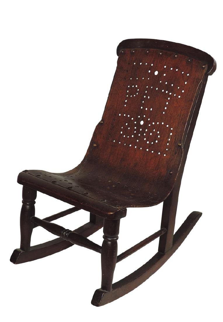 Children's rocker, oak w/perforated wood back that