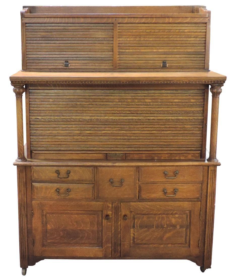 Dentist's cabinet, quartersawn oak, 3-roll top doors