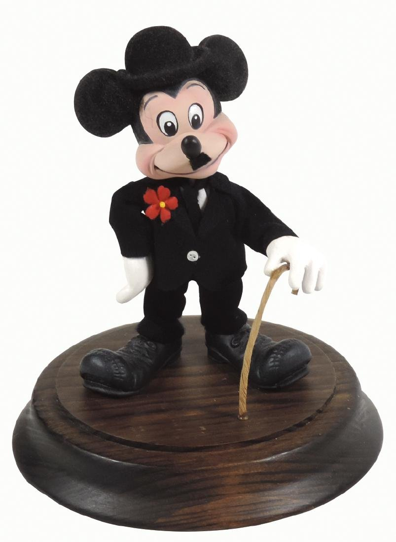 Disney figure, Mickey Mouse dressed as Charlie Chaplin,
