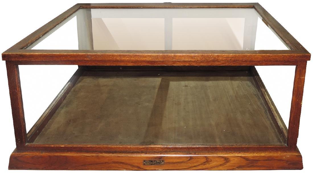 Showcase, countertop, oak w/sliding mirrored back