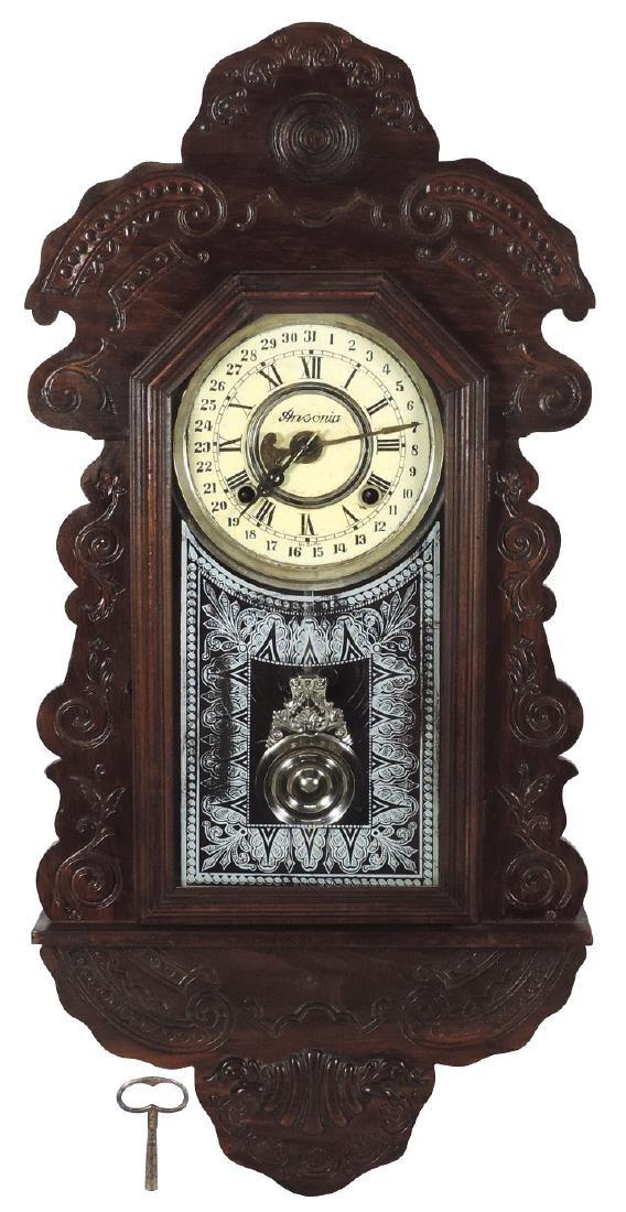 Clock, Ansonia, oak 8-day wall clock w/ pressed &