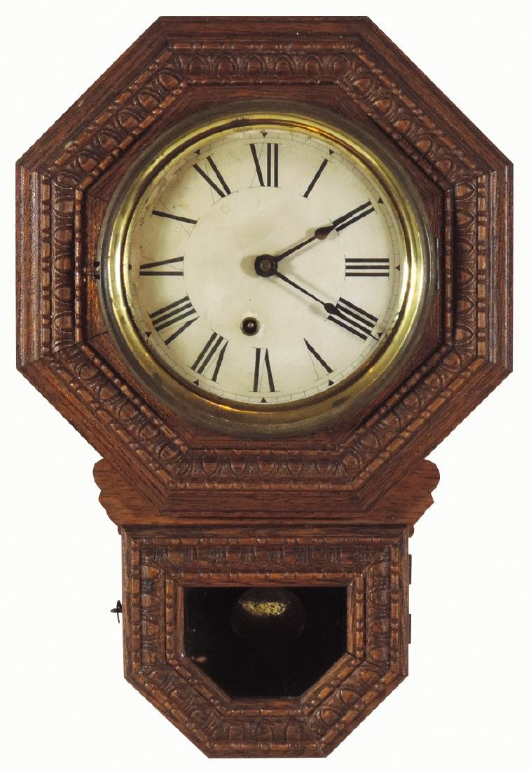 Clock, 8 inch drop octagon wall regulator, mfgd by The