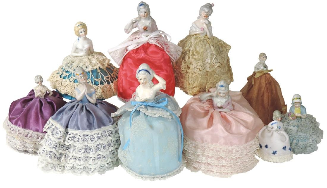 Porcelain half-doll pin cushions (10), Victorian-era