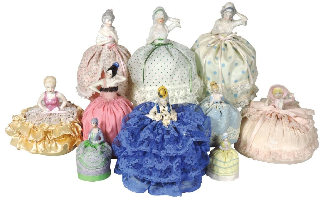 Porcelain half-doll pin cushions (10), Victorian to