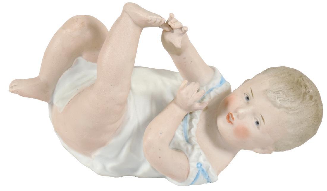 Porcelain piano baby, Gebruder Heubach, Germany,