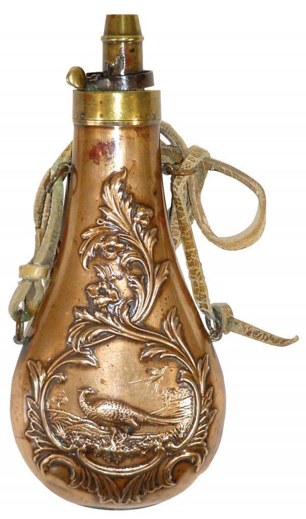 15: Shot flask, ornate embossed copper & brass, center