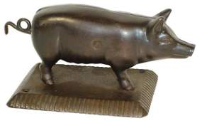945 Figural cigar cutter cast iron pig on rectangular