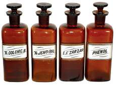 1030: Drug store apothecary bottles (4), square amber l