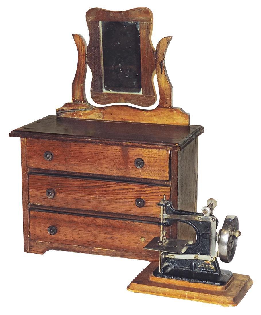 "Toy sewing machine & dresser (2), marked ""Baby"" on"