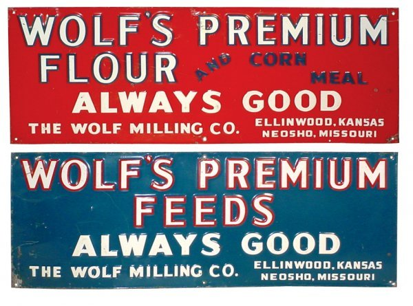 0009: Wolf's Flour & Feed signs (2), both embossed tin,