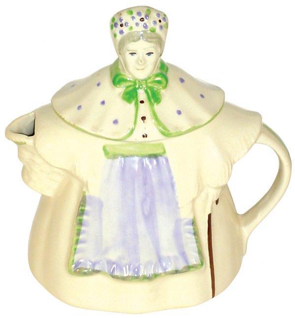 0023: Shawnee teapot, Granny Ann, purple & green apron,