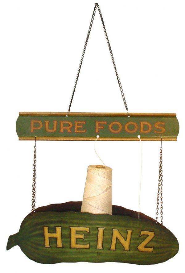 0484: Heinz string holder, pickle-shaped litho on embos