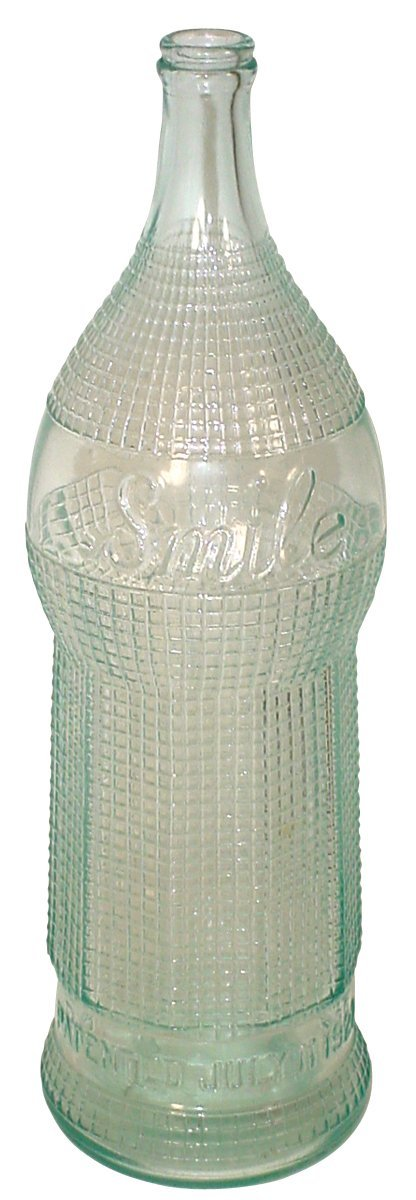 0762: Smile Soda Pop oversized embossed glass display b