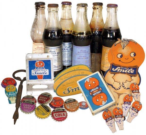 0764: Smile Soda Pop items (28), 6 old Smile Soda bottl